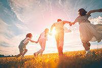 A family running through a field
