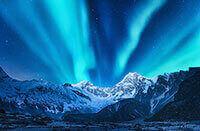 Aurora borealis over snowcapped mountains