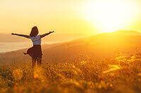 A woman enjoying a sunrise outdoors