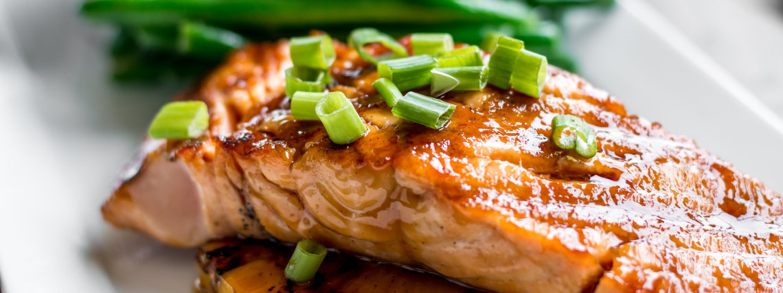 Rum glazed salmon with wedges and greens
