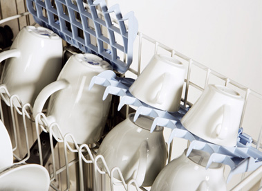 Mugs in top rack of dishwasher