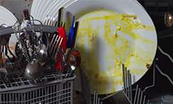 Unrinsed plates in a dishwasher