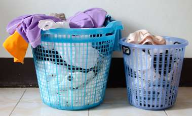 Try to wash your own clothing separately to the other people you live with