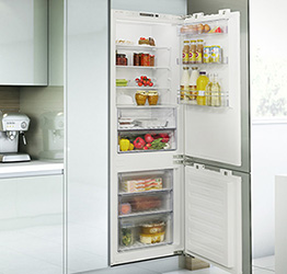 integrated fridge with cupboard door to match the kitchen units